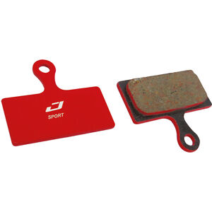 Jagwire Sport Semi-Metallic Bremsbeläge für Shimano | Rever Postmount 1 Paar rot